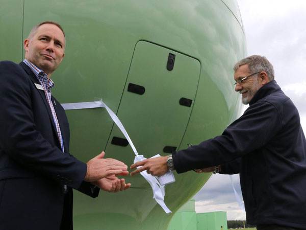 Rescue Coordination Centre Manager Mike Hill (left) with Maritime NZ Director Keith Manch as the ribbon is cut to mark the completion of the new earth station