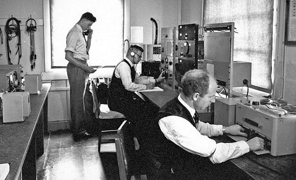 Mt Crawford receiver site in the late 1950s or early 1960s. WH (Bill) Deverall (centre) and Eric J Dinnan (right)