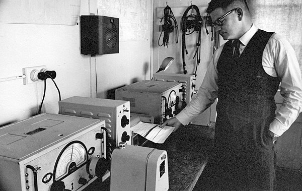 WH (Bill) Deverall with the Marconi CSR5 receivers at Mt Crawford in the late 1950s or early 1960s