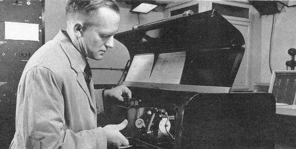 George Bourne with radio photo receiver at the Overseas Terminal, GPO