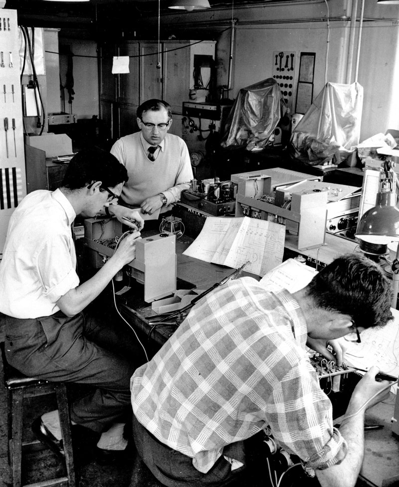 Jim Whitney (standing) overseeing trainees BJ Hodgkinson (left) and Dennis Moore (right)